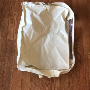 Cream full-zip sheer panel clothes storage bag
